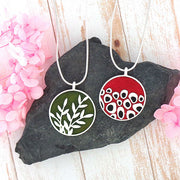 Online shopping for LAVISHY's handmade silver plated reversible pendant necklace with leaf & geometric pattern enamel pattern. Great for everyday wear & lovely gift for friends & family. Wholesale at www.lavishy.com for gift shops, clothing & fashion accessories boutiques in Canada, USA & worldwide since 2001.