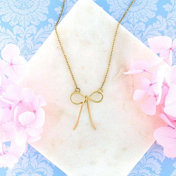 Shop LAVISHY rhodium or 12k gold plated dainty butterfly bow necklace from Poco collection by LAVISHY. A playful gift for yourself or your friends & family. Wholesale available at www.lavishy.com with many unique & fun fashion accessories for gift shops, fashion accessories & clothing boutiques in Canada, USA and worldwide..