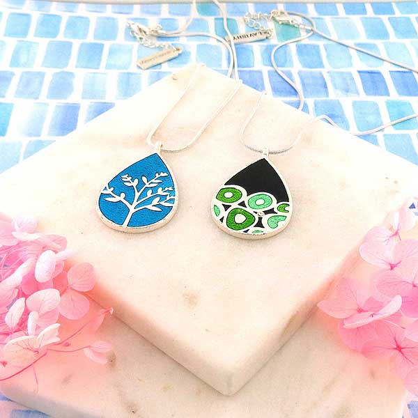 Online shopping for LAVISHY's handmade silver plated reversible pendant necklace with tree of life & geometric pattern enamel pattern. Great for everyday wear & lovely gift for friends & family. Wholesale at www.lavishy.com for gift shops, clothing & fashion accessories boutiques in Canada, USA & worldwide since 2001.