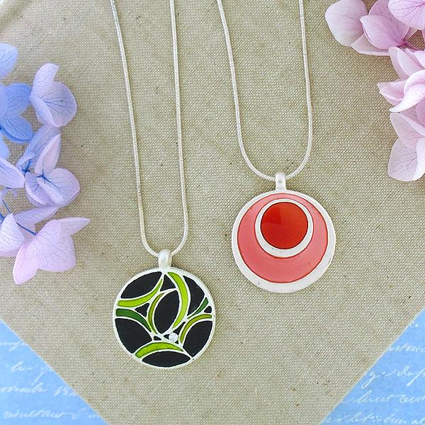 Online shopping for LAVISHY's handmade silver plated reversible pendant necklace with enamel geometric pattern. Great for everyday wear & lovely gift for friends & family. Wholesale at www.lavishy.com for gift shops, clothing & fashion accessories boutiques in Canada, USA & worldwide since 2001.
