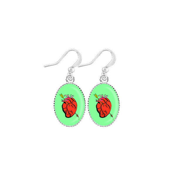 Shop LAVISHY's unique, handmade cute & dainty sacred heart earrings inspired by Mexican folk art print. A quirky & fun gift for you or your girlfriend, wife, co-worker, friend & family. Wholesale available at www.lavishy.com with many unique & fun fashion accessories.