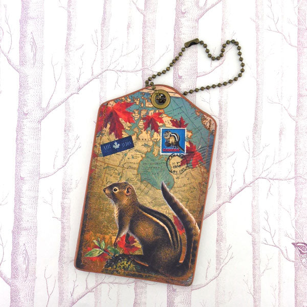 Shop vegan brand LAVISHY's cool vegan/faux leather luggage tag with vintage style Canadian chipmunk illustration on the Canadian map background print. It's a great traveler or as a gift. Wholesale available at www.lavishy.com with other unique fashion/travel accessories/souvenirs.