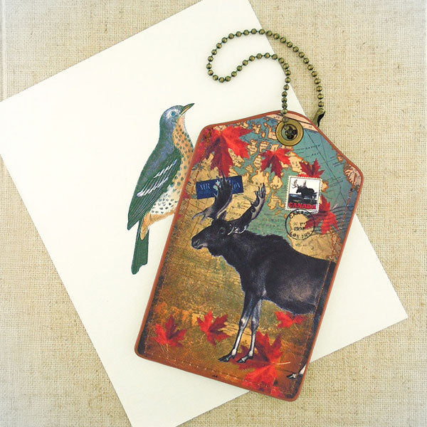 Shop PETA approved vegan brand LAVISHY's cool vegan/faux leather luggage tag with vintage style Canadian moose illustration on the Canadian map background print. It's a great traveler or as a gift. Wholesale available at www.lavishy.com with other unique fashion/travel accessories/souvenirs.