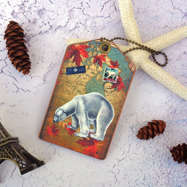 Shop vegan brand LAVISHY's cool vegan/faux leather luggage tag with vintage style Canadian polar bear illustration on the Canadian map background print. It's a great traveler or as a gift. Wholesale available at www.lavishy.com with other unique fashion/travel accessories/souvenirs.
