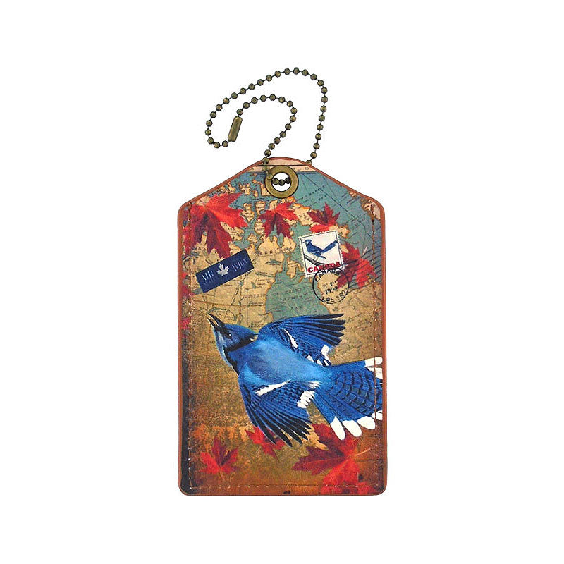 Shop PETA approved vegan brand LAVISHY's cool vegan/faux leather luggage tag with vintage style Canadian blue jay illustration on the Canadian map background print. It's a great traveler or as a gift. Wholesale available at www.lavishy.com with other unique fashion/travel accessories/souvenirs.