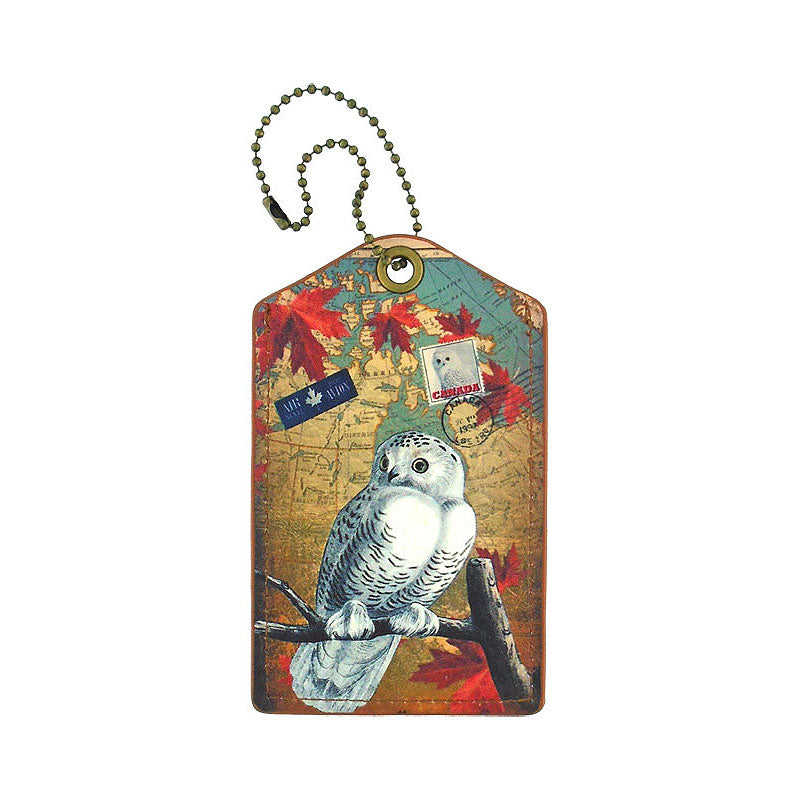 Shop PETA approved vegan brand LAVISHY's cool vegan/faux leather luggage tag with vintage style Canadian snowy owl illustration on the Canadian map background print. It's a great traveler or as a gift. Wholesale available at www.lavishy.com with other unique fashion/travel accessories/souvenirs.