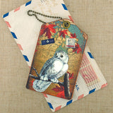 Shop vegan brand LAVISHY's cool vegan/faux leather luggage tag with vintage style Canadian snowy owl illustration on the Canadian map background print. It's a great traveler or as a gift. Wholesale available at www.lavishy.com with other unique fashion/travel accessories/souvenirs.