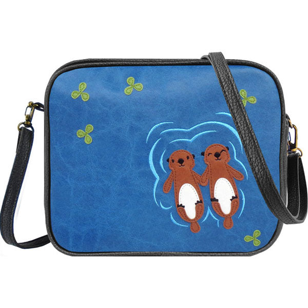 Shop vegan brand LAVISHY's sea otter lovers applique vegan/faux leather cell phone wallet/bag. Wholesale available at http://www.lavishy.com/lookbook/lavishy-adora-collection-look-book.htm
