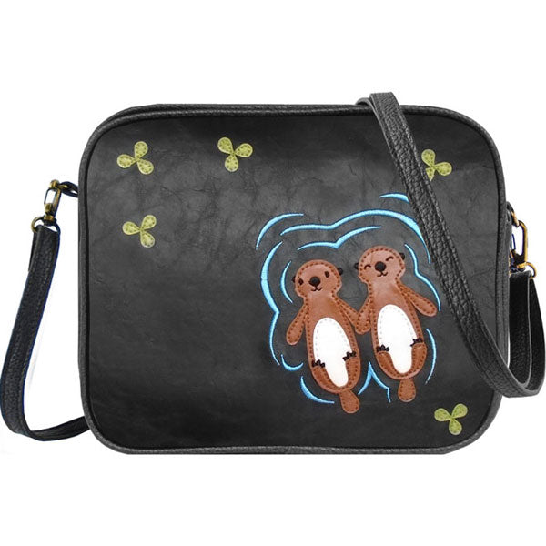 Online shopping for LAVISHY fun & playful applique vegan leather cross body bag/toiletry bag with adorable sea otter lovers applique. It's Eco-friendly, ethically made, cruelty free. A great gift for you or your friends & family. Wholesale available at www.lavishy.com with many unique & fun fashion accessories.