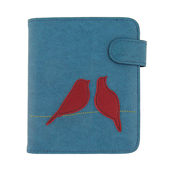 Online shopping for vegan brand LAVISHY's fun & playful applique vegan/faux leather passport/travel wallet with adorable love birds applique. It's a great gift idea for you or your friends & family. Wholesale available at www.lavishy.com with many unique & fun fashion accessories.