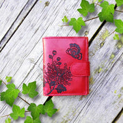 Online shopping for vegan brand LAVISHY's Eco-friendly cruelty free embossed chrysanthemum flower & butterfly vegan medium wallet for women. Great for everyday use, a beautiful gift for family & friends. Wholesale at www.lavishy.com for gift shops, fashion accessories &d clothing boutiques, book stores in Canada, USA & worldwide since 2001.
