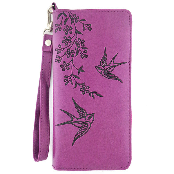 Shop LAVISHY embossed vegan leather large wristlet wallet with love swallow birds motif. This product is available for wholesale at www.lavishy.com where gift shop and boutique buyers can order unique & fun vegan bags, wallets, coin purses, travel accessories, fashion jewelry & gifts designed by PETA approved vegan brand LAVISHY.