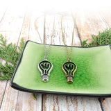 Shop LAVISHY's unique, beautiful & affordable vintage look retro style big bright idea light bulb pendant necklace. It's fun to wear everyday also make great gift for your family & friends. Wholesale at www.lavishy.com to gift shop, clothing & fashion accessories boutique, book store since 2001.