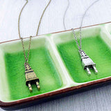 Shop LAVISHY's unique, beautiful & affordable retro style electrical plug necklace. It's fun to wear everyday also make great gift for your family & friends. Wholesale at www.lavishy.com with many unique & fun fashion accessories to gift shop, clothing & fashion accessories boutique, book store since 2001.
