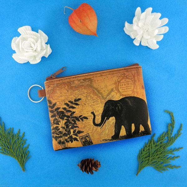 Online shopping for vegan brand LAVISHY's unisex key ring coin purse with vintage style elephant illustration on the old map background print. Great for everyday use, travel & gift for friends & family. Wholesale at www.lavishy.com for gift shops, fashion accessories & clothing boutiques, book stores worldwide since 2001.