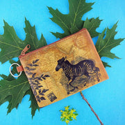 Online shopping for vegan brand LAVISHY's unisex key ring coin purse with vintage style zebra illustration on the old map background print. Great for everyday use, travel & gift for friends & family. Wholesale at www.lavishy.com for gift shops, fashion accessories & clothing boutiques, book stores worldwide since 2001.