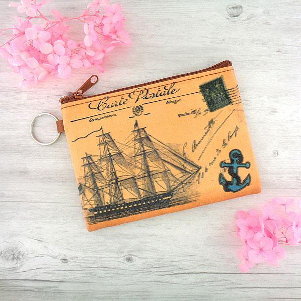 Online shopping for vegan brand LAVISHY's unisex key ring coin purse with vintage style boat illustration on the old map background print. Great for everyday use, travel & gift for friends & family. Wholesale at www.lavishy.com for gift shops, fashion accessories & clothing boutiques, book stores worldwide since 2001.