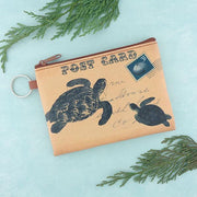 Online shopping for vegan brand LAVISHY's unisex key ring coin purse with vintage style sea turtle illustration on the old map background print. Great for everyday use, travel & gift for friends & family. Wholesale at www.lavishy.com for gift shops, fashion accessories & clothing boutiques, book stores worldwide since 2001.