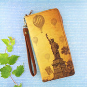 Online shopping for vegan brand LAVISHY's cool wristlet large wallet with vintage style New York Statue of Liberty illustration on old map background print. Great for everyday use & travel. A cool gift for family & friends. Wholesale at www.lavishy.com for gift shops, fashion accessories & clothing boutiques, book stores since 2001.