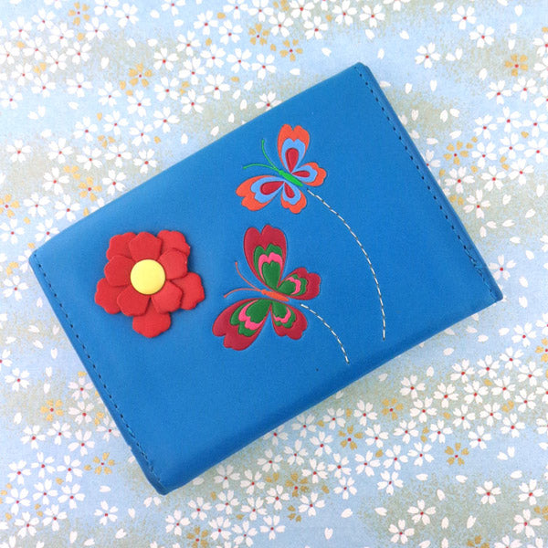 Shop PETA approved vegan brand LAVISHY's beautiful vegan cardholder with charming butterfly and flower emboss motif. It's Eco-friendly, ethically made, cruelty free. A great gift for you or your friends & family. Wholesale available at www.lavishy.com with many unique & fun fashion accessories.
