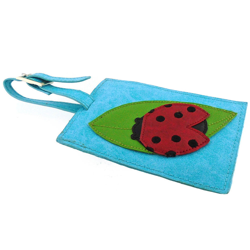 Online shopping for vegan brand LAVISHY's fun & playful applique vegan/faux leather luggage tag with adorable ladybug applique. It's Eco-friendly, ethically made, cruelty free. A great gift for you or your friends & family. Wholesale at www.lavishy.com with many unique & fun fashion accessories.