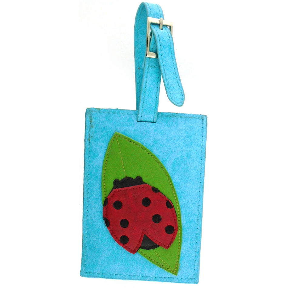 Shop vegan brand LAVISHY's ladybug applique vegan/faux leather luggage tag. Wholesale available at http://www.lavishy.com/lookbook/lavishy-adora-collection-look-book.htm