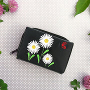 Designed by vegan brand LAVISHY, this Eco-friendly, ethically made, cruelty free small tri-fold wallet for women features delightful embroidery motif of daisy & ladybug. Wholesale available at www.lavishy.com along with other unique & fun vegan fashion accessories for retailers like gift shop & boutique.