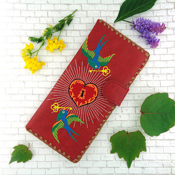 Designed by PETA approved vegan brand LAVISHY, this Eco-friendly, ethically made, cruelty free large flat wallet for women features delightful embroidery motif of tattoo love birds. Wholesale available at www.lavishy.com along with other unique & fun vegan fashion accessories for retailers like gift shop & boutique.