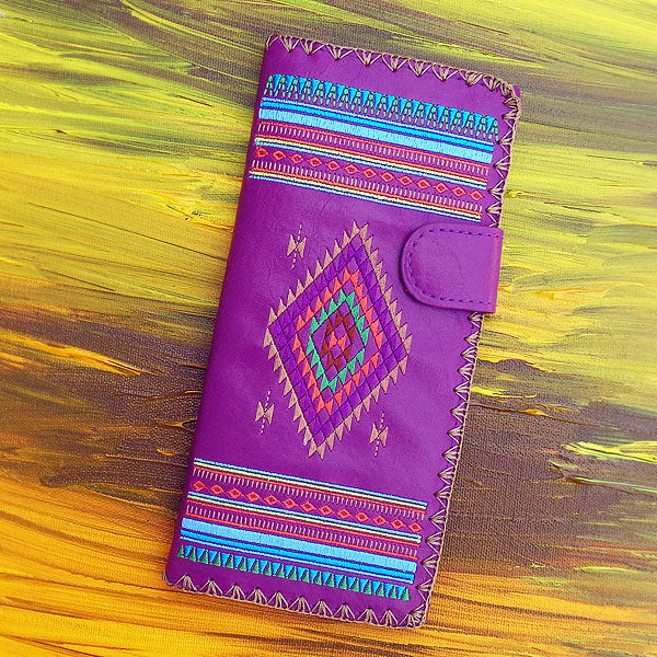 Designed by PETA approved vegan brand LAVISHY, this Eco-friendly, ethically made, cruelty free large flat wallet for women features delightful embroidery motif of tribal pattern. Wholesale available at www.lavishy.com along with other unique & fun vegan fashion accessories for retailers like gift shop & boutique.