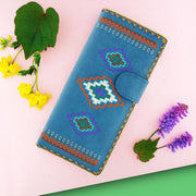 Online shopping for vegan brand LAVISHY's Eco-friendly, ethically made, cruelty free embroidered large flat wallet for women features American Southwest tribal pattern embroidery motif. Wholesale at www.lavishy.com for retailers like gift shop, clothing & fashion accessories boutique & book store worldwide since 2001.