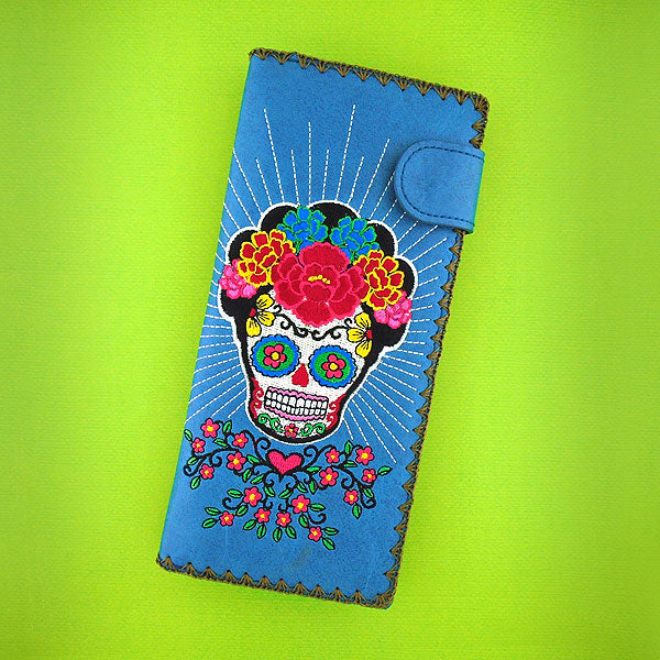 Designed by PETA approved vegan brand LAVISHY, this Eco-friendly, ethically made, cruelty free large flat wallet for women features delightful embroidery motif of sugar skull. Wholesale available at www.lavishy.com along with other unique & fun vegan fashion accessories for retailers like gift shop & boutique.