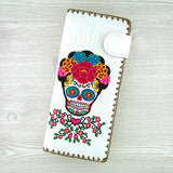 Online shopping for vegan brand LAVISHY's Eco-friendly, ethically made, cruelty free embroidered large flat wallet for women features Mexican Frida style sugar skull with corolla Flower. Wholesale at www.lavishy.com for retailers like gift shop, clothing & fashion accessories boutique & book store worldwide since 2001.