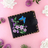 Shop embroidered butterfly & cherry blossom flower vegan medium wallet for women by vegan brand LAVISHY, this Eco-friendly, ethically made, cruelty free wallet's lovely embroidery motif is framed by decorative stitches around the edge. Wholesale at www.lavishy.com with unique & fun fashion accessories for gift shop, boutique & corporate buyers.