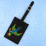 Shop vegan brand LAVISHY's embroidered luggage tag with tattoo style swallow bird with golden key motif. It's Eco-friendly, ethically made, cruelty free. A great gift for you or your friends & family. Wholesale available at www.lavishy.com with many unique & fun fashion accessories.
