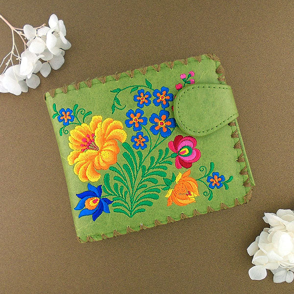 Shop embroidered Hungarian flower vegan medium bifold wallet for women by vegan brand LAVISHY, this Eco-friendly, ethically made, cruelty free wallet's lovely embroidery motif is framed by decorative stitches around the edge. Wholesale at www.lavishy.com with uniquefun fashion accessories for gift shop, boutique & corporate buyers.