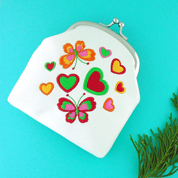 Online shopping for vegan brand LAVISHY's butterfly & heart embroidered kiss lock frame vegan coin purse that is Eco-friendly, ethically made, cruelty free. Great for everyday use or a gift for your family & friends. Wholesale at www.lavishy.com to gift shops, fashion accessories & clothing boutiques worldwide since 2001.
