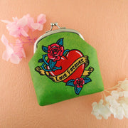 Designed by vegan brand LAVISHY, this Eco-friendly, ethically made, cruelty free retro style kiss lock frame coin purse with lovely tattoo love birds embroidery motif. Wholesale available at www.lavishy.com along with other unique & fun vegan fashion accessories for retailers like gift shop & boutique.