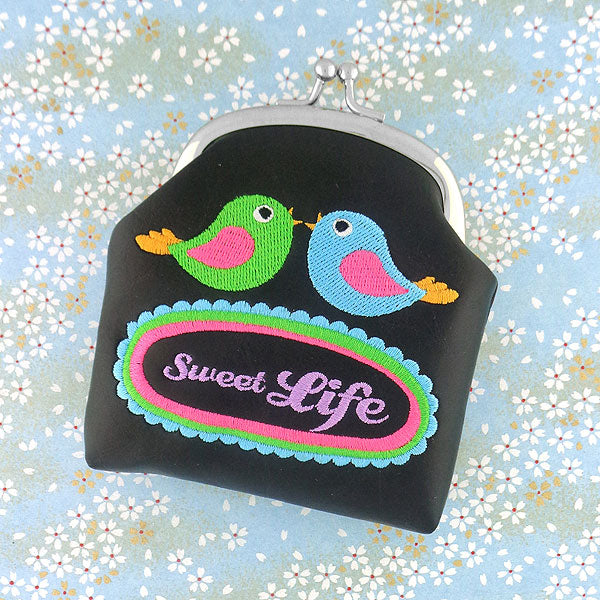 Shop vegan brand LAVISHY's sweet life love birds & flower embroidered kiss lock frame vegan coin purse that is Eco-friendly, ethically made, cruelty free. Great for everyday use or a gift for your family & friends. Wholesale at www.lavishy.com to gift shops, fashion accessories & clothing boutiques worldwide since 2001.