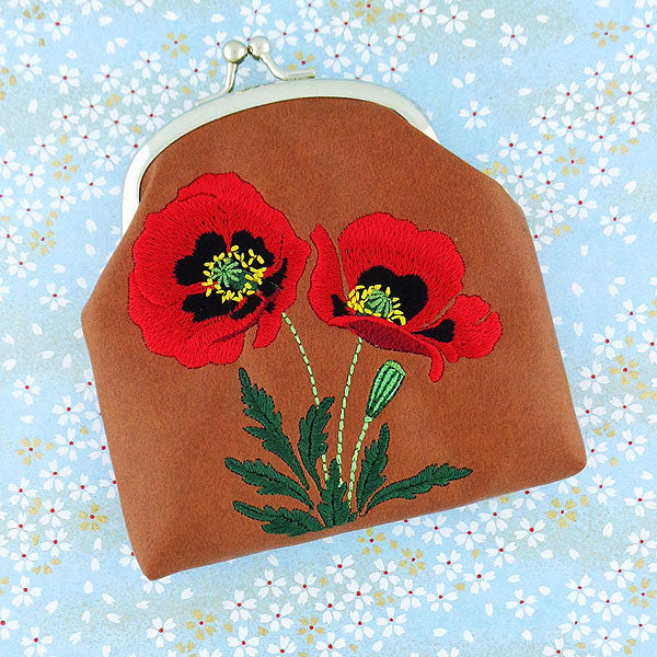 Designed by PETA approved vegan brand LAVISHY, this Eco-friendly, ethically made, cruelty free retro style kiss lock frame coin purse with lovely poppy embroidery motif. Wholesale available at www.lavishy.com along with other unique & fun vegan fashion accessories for retailers like gift shop & boutique.