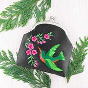 Shop vegan brand LAVISHY's hummingbird & flower embroidered kiss lock frame vegan coin purse that is Eco-friendly, ethically made, cruelty free. Great for everyday use or a gift for your family & friends. Wholesale at www.lavishy.com to gift shops, fashion accessories & clothing boutiques worldwide since 2001.