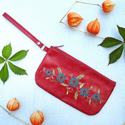Online shopping for vegan brand LAVISHY's embroidered vegan/faux leather wristlet with delightful carnation flower embroidery motif.It's Eco-friendly, ethically made, cruelty free. A great gift for you or your friends & family. Wholesale available at www.lavishy.com with many unique & fun fashion accessories.