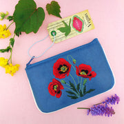 Shop vegan brand LAVISHY's poppy flower embroidered vegan small pouch/coin purse that is Eco-friendly, ethically made, cruelty free. Great for everyday use or a gift for your family & friends. Wholesale at www.lavishy.com to gift shops, fashion accessories & clothing boutiques worldwide since 2001.