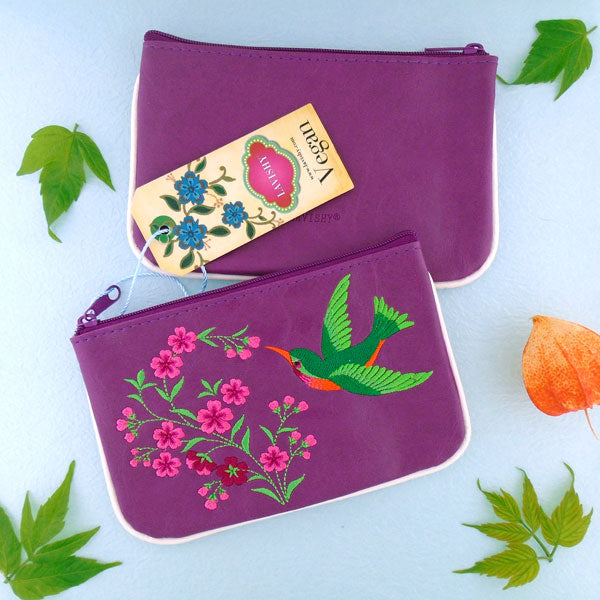 Designed by PETA approved vegan brand LAVISHY, this Eco-friendly, ethically made, cruelty free small pouch for women features lovely embroidery motif of hummingbird. Wholesale available at www.lavishy.com along with other unique & fun vegan fashion accessories for retailers like gift shop & boutique.