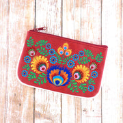 Designed by PETA approved vegan brand LAVISHY, this Eco-friendly, ethically made, cruelty free small pouch for women features Polish folk art inspired flower embroidery motif. Wholesale available at www.lavishy.com along with other unique & fun vegan fashion accessories for retailers like gift shop & boutique.