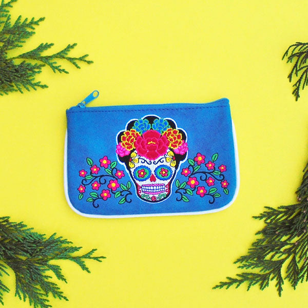 Designed by PETA approved vegan brand LAVISHY, this Eco-friendly, ethically made, cruelty free small pouch for women features lovely embroidery motif of sugar skull. Wholesale available at www.lavishy.com along with other unique & fun vegan fashion accessories for retailers like gift shop & boutique.