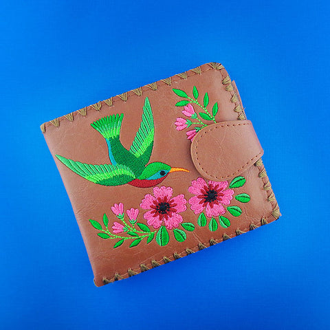 Online shopping for vegan brand LAVISHY's embroidered hummingbird & flower medium bifold wallet for women that is Eco-friendly, ethically made, cruelty free. Great for everyday use or a gift for your family & friends. Wholesale at www.lavishy.com to gift shops, fashion accessories & clothing boutiques worldwide since 2001.