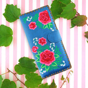 Designed by vegan brand LAVISHY, this Eco-friendly, ethically made, cruelty free large flat wallet for women features delightful embroidery motif of Mexican rose. Wholesale available at www.lavishy.com along with other unique & fun vegan fashion accessories for retailers like gift shop & boutique.