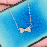 Online shopping for rhodium plated crystal studded bow pendant necklace. A great gift for you or your girlfriend, wife, co-worker, friend & family. Wholesale at www.lavishy.com with many unique & fun fashion accessories.