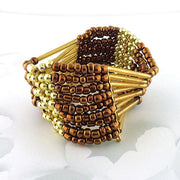 Online shopping for bohemian style handmade brown and gold glass beads stretchable bracelet by LAVISHY exclusive for LAVISHY Boutique. The earthy color combination will add exotic flare to your look. A great gift for you or your girlfriend, wife, co-worker, friend & family. These are exclusive for LAVISHY Boutique only.