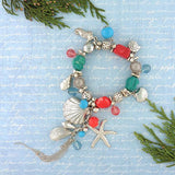 Celebrate your love for ocean with this handmade stretchable bracelet with metal and charms and resin beads. The sea shell charms, starfish charm, seahorse charms and metal tassel will add charm to your wrist during your beach vacation. It also will make a great gift for your loved ones who enjoy coastal lifestyle.